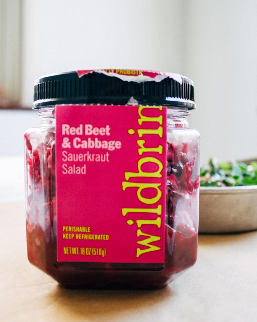 Chopped Kale + Kraut Salad w/ Millet + Sunflower Ranch Dressing | Well and Full | #vegan #recipe