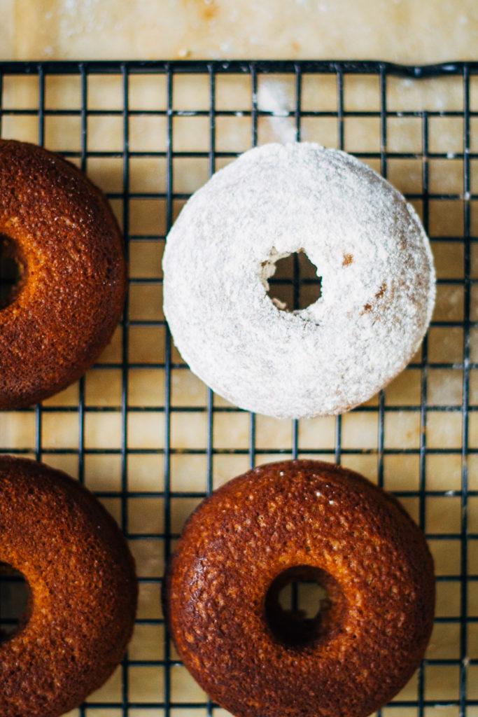 Fluffy Vegan Apple Cider Donuts w/ Powdered Cinnamon Sugar | Well and Full | #vegan #plantbased #recipe